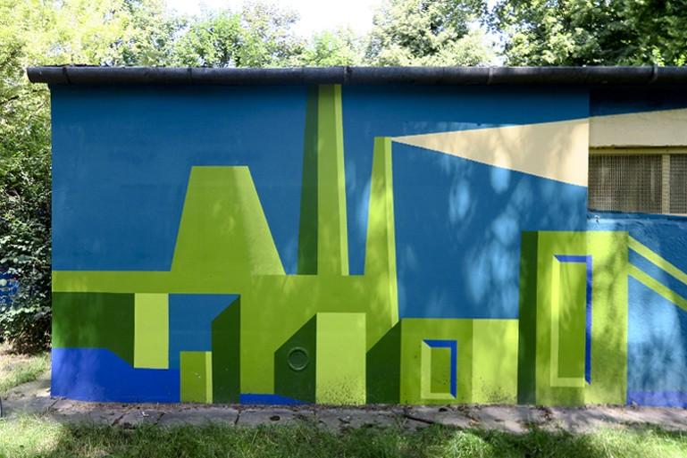 """Fragment muralu Dariusza Milczarka """"Przeszłość – współczesność – przyszłość Nowej Huty"""""""